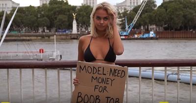 Es sieht aus, als würde sie Geld für eine Vergrößerung ihrer Oberweite sammeln